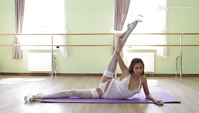 Russian ballerina in white stockings Inessa Sabchak shows off pussy and small perky ninnies