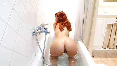 Bodily red head Agatha is playing nearly her favorite sex toy in the shower